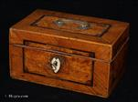 736MB: A box in a striking combination of ash and ice-birch veneers, banded and delineated, with a carrying handle on the top and bone escutcheon. Circa 1780